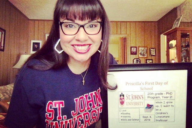 Priscilla Delgado with a sign on her Frist Day of School for her Ph.D. program in 2019