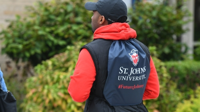Back view of student wearing a St. John's backpack