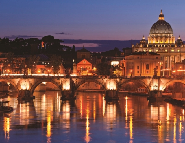 Evening shot of Rome reflecting in the Tiber River