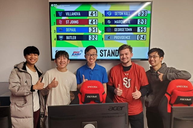 St. John's eSports league members in front of a monitor
