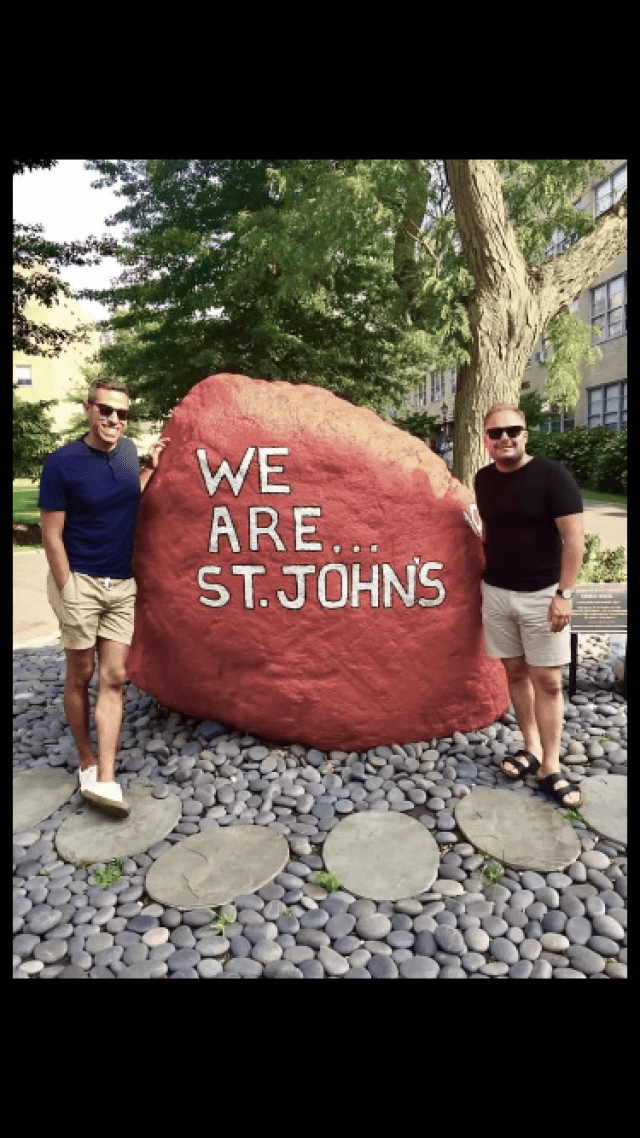 To alumni Daniel Drebycz and Javier Urena standing next to SJU Spirit Rock