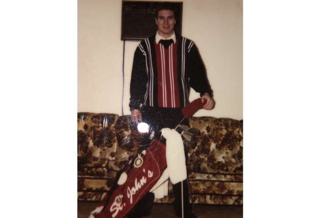 Alumni Mike O'Shea showing off his St. John's logo golf bag from 1995 as a member of the golf team