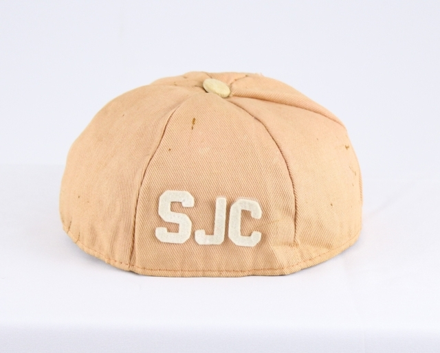 This freshman beanie was worn by Thomas Gould, class of 1958, during freshman hazing in Fall 1954.
