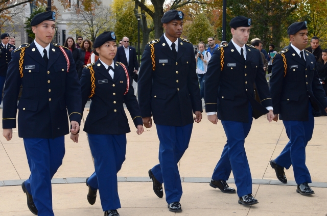 5 students dressed in ROTC uniform walking