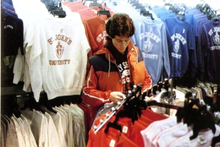 A student browses the many colorful St. John's University sweatshirts at the campus bookstore in 1982.