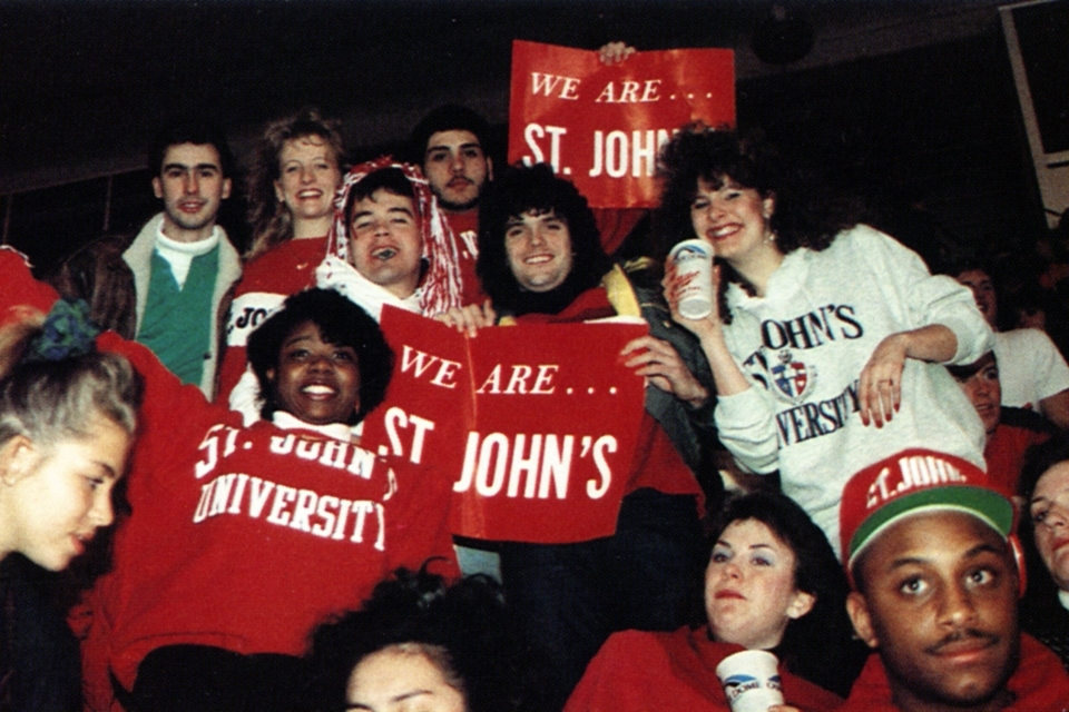 students holding We Are St. John's signs