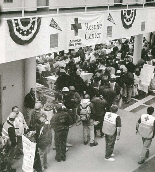 Emergency response workers standing in the lobby of 101 Murray Street, with a banner that reads American Red Cross Respite Center