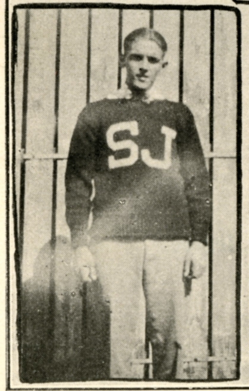 A student wearing a varsity sweater with the letters SJ in 1926